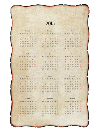 Old, decrepit calendar 2015 with charred edges, grunge. Isolated on white.  photo