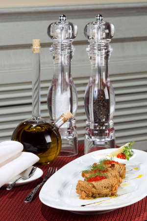 sturgeon: Dish of salmon with bread and red caviar. Blurred background.
