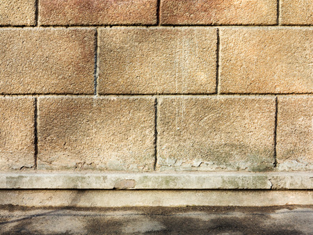 grunge background, brick wall texture plaster wall and blocks road sidewalk abandoned exterior urban background for your concept or project photo