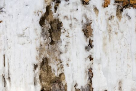 rust covered: Abstract background of stone wall covered with rust and ice winter day Stock Photo