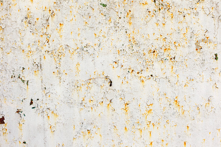 Abstract rusty metal surface with cracked white paint. Textured background for your concept or project. Great background or texture. photo