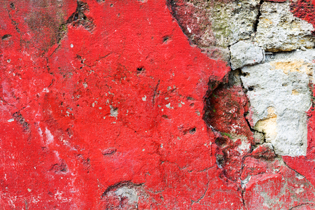 magentas: Dirty concrete wall with red stains water stains, cracks and scratches. Grungy concrete surface. Great background or texture for your project.