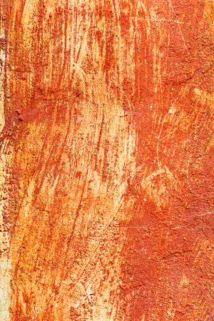 Creative beautiful bright orange background, cracks and scratches on the concrete. Grungy concrete surface. Great background or texture for your project. photo