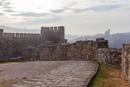 veliko: Ruins of an ancient fortress on a foggy winter day. Veliko Tarnovo , Bulgaria