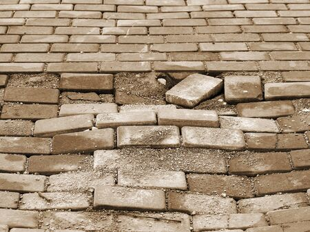 requires: Destroyed paving slabs, requires urgent repairs. Selective focus