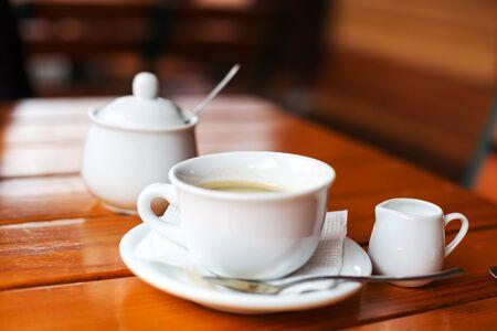 stimulator: Cup of coffee. Morning atmospheric lighting, fashionable trendy spot soft focus. Preparation for design creative menu. Stock Photo