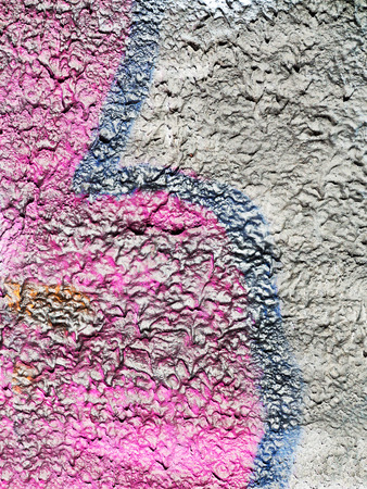 bullies: Hooligan smeared paint the walls of the old building. Landscape style. Grungy concrete surface with cracks, scratches and streaks of paint. Great or texture. Stock Photo