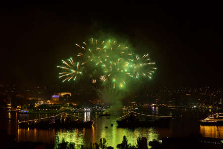 Sevastopol, Crimea - May 9, 2015: salute 70 years of the Victory in the Great Patriotic War, against the background of Russian military ships in the bay of Sevastopol