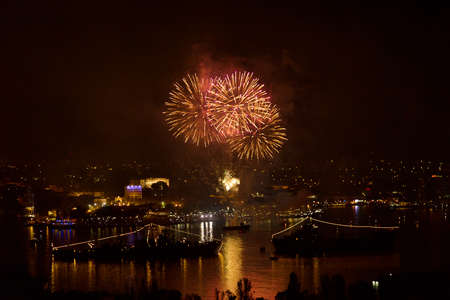 may 9: Sevastopol, Crimea - May 9, 2015: salute 70 years of the Victory in the Great Patriotic War, against the background of Russian military ships in the bay of Sevastopol