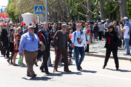 SEVASTOPOL  CRIMEA - MAY 9, 2015: People are columns in the Parade in honor of the 70th anniversary of Victory Day, May 9, 2015 in Sevastopol Editorial