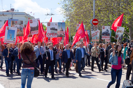 forefather: SEVASTOPOL  CRIMEA - MAY 9, 2015: People are columns in the Parade in honor of the 70th anniversary of Victory Day, May 9, 2015 in Sevastopol Editorial