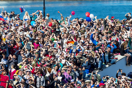 militiaman: SEVASTOPOL  CRIMEA - MAY 9, 2015: A lot of people watching the parade in honor of the 70th anniversary of Victory Day, May 9, 2015 in Sevastopol