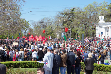forefather: SEVASTOPOL  CRIMEA - MAY 9, 2015: A lot of people watching the parade in honor of the 70th anniversary of Victory Day, May 9, 2015 in Sevastopol