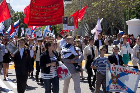 forefather: SEVASTOPOL  CRIMEA - MAY 9, 2015: The Immortal regiment marches. The parade in honor of 70th anniversary of Victory Day May 9, 2015 in Sevastopol