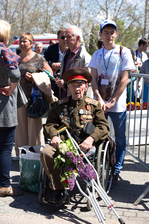 militiaman: SEVASTOPOL  CRIMEA - MAY 9, 2015: Veterans at the parade in honor of the 70th anniversary of Victory Day, May 9, 2015 in Sevastopol