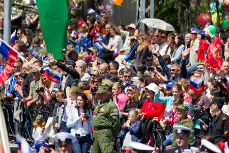 militiaman: SEVASTOPOL, CRIMEA - MAY 9, 2015: A lot of people watching the parade in honor of the 70th anniversary of Victory Day on 9 May 2015, Sevastopol