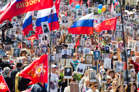 militiaman: SEVASTOPOL, CRIMEA - MAY 9, 2015: The Immortal regiment marches. The parade in honor of 70th anniversary of Victory Day MAY 9, 2015, Sevastopol Editorial