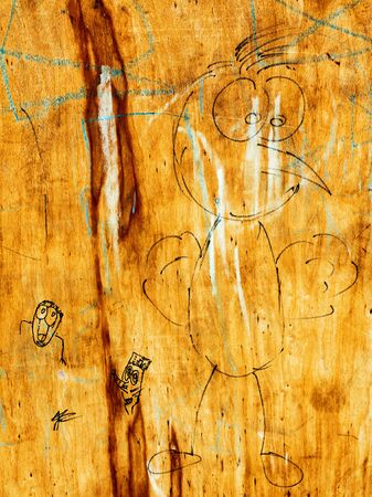 plywood: creative drawings on old plywood, perfect background for your concept or project. Landscape style. Great background or texture. Stock Photo