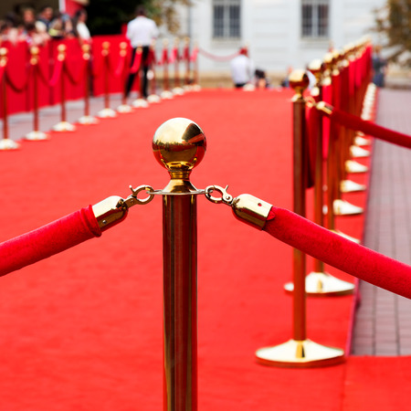 red line: Way to success on the red carpet (Barrier rope) Stock Photo