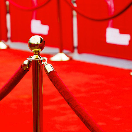 red carpet background: Way to success on the red carpet (Barrier rope) Stock Photo