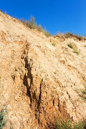 sandy soil: The collapse of wet sandy soil on the coast Stock Photo