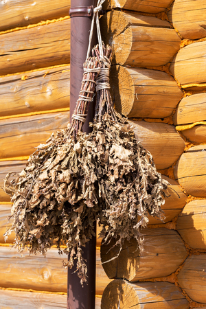 brooms: Harvested oak brooms for a bath, hang in the barn Stock Photo