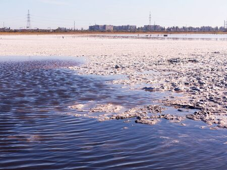 receded: Petrified salt made dry red estuary. Kuyalnik in Odessa, Ukraine. The water has receded far into the result of the strong summer drought. Ecological catastrophy. The destruction of nature. Stock Photo
