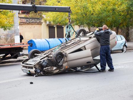 hauler: ODESSA, UKRAINE - OCTOBER 24, 2015: car hauler picks up after a car accident October 24, 2015 in Odessa, Ukraine