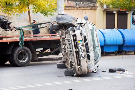 rescuing: ODESSA, UKRAINE - OCTOBER 24, 2015: car hauler picks up after a car accident October 24, 2015 in Odessa, Ukraine