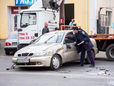 turnout: ODESSA, UKRAINE - OCTOBER 24, 2015: car hauler picks up after a car accident October 24, 2015 in Odessa, Ukraine