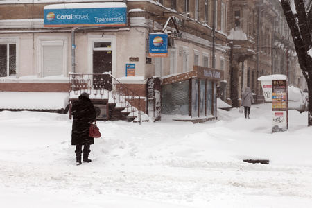 hurricane lamp: ODESSA - January 18, 2016: On snow-covered street. People go along the street during a snowfall. January 18, 2016 in Odessa, Ukraine Editorial