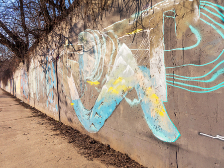 Zhitomir, Ukraine - February 7: Detail of graffiti on a concrete wall. Grungy concrete surface with cracks, scratches and streaks of paint. February 7, 2016 in Zhitomir, Ukraine