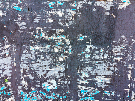 torn metal: Creative background of rusty metal, painted gray paint carelessly with the remnants of torn paper.