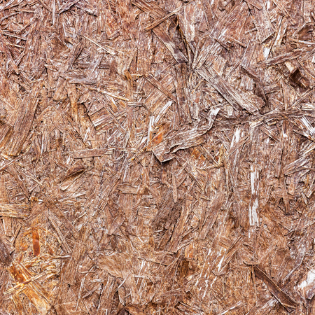 compressed: Close up of a recycled compressed wood chippings board
