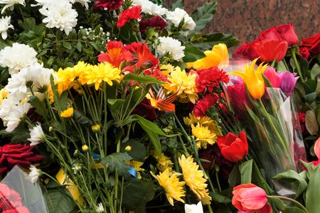 granite slab: Flowers lie on the granite slab monument to soldiers