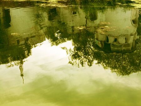 Reflection in the water of an old fortress matte