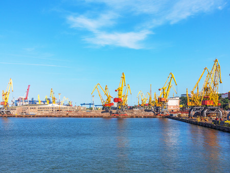 paralyzed: Odessa, Ukraine - July 6, 2016: Container cranes in cargo port terminal, cargo cranes without job in an empty harbor port. A crisis. Defaulted paralyzed entire economy of state
