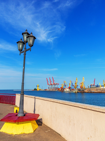 Odessa, Ukraine - July 6, 2016: Container cranes in cargo port terminal, cargo cranes without job in an empty harbor port. A crisis. Defaulted paralyzed entire economy of state