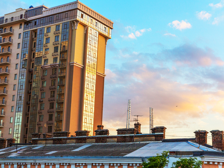 Odessa, Ukraine July 6, 2016: The old roofs on a background of a modern high-rise building, the sunset at the end of the day in Odessa, Ukraine, July 6, 2016 Editorial