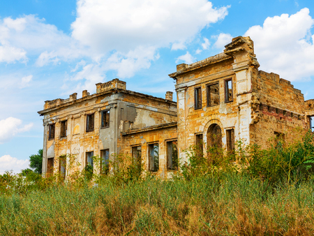 The ruins of an ancient house in Odessa, Ukraine. Historic building destroyed by vandals of the proletariat during a revolution in Russia in the 20th century. Stock Photo