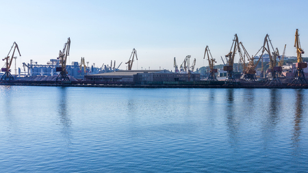Odessa, Ukraine - August 15, 2016: Container cranes in cargo port terminal, cargo cranes without job in an empty harbor port. A crisis. Defaulted paralyzed entire economy in Odessa, Ukraine, August 15, 2016