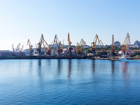 paralyzed: Odessa, Ukraine - August 15, 2016: Container cranes in cargo port terminal, cargo cranes without job in an empty harbor port. A crisis. Defaulted paralyzed entire economy in Odessa, Ukraine, August 15, 2016