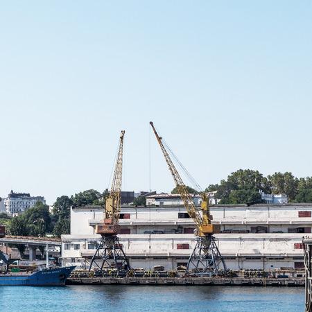 Odessa, Ukraine - August 15, 2016: Container cranes in cargo port terminal, cargo cranes without job in an empty harbor port. A crisis. Odessa, Ukraine, August 15, 2016 Editorial