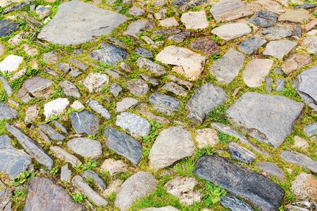 piedra de pavimentación urbana, perspectiva. Textura, fondo, atención selectiva