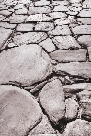 paved: Tinted urban road is paved with blocks of stone, cobblestone walkway Stock Photo