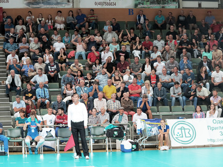 european championship: ODESSA, UKRAINE - September 18, 2016: Fans in the stands during a volleyball at the European Championship in volleyball sports complex in South, September 18, 2016