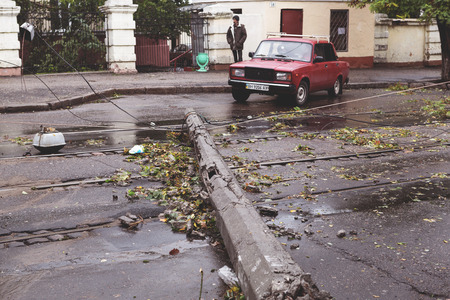 underestimate: Odessa, Ukraine - October 12, 2016: Hurricane CHRISTIE. Heavy rain and gale - force gusts of wind caused accident - old tree during storm fell on car and destroyed house. Strong storm with rain Editorial