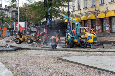 overhaul: Odessa, Ukraine - October 11, 2016: Major overhaul of urban roads and tram tracks. The workers, construction equipment on site