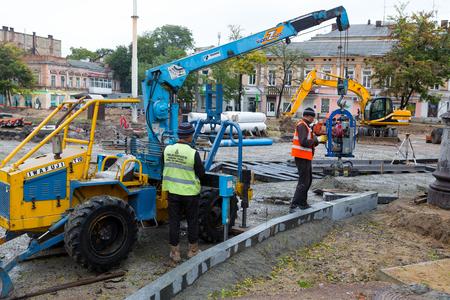 Odessa, Ukraine - October 11, 2016: Major overhaul of urban roads and tram tracks. The workers, construction equipment on site