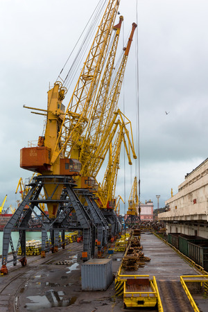 paralyzed: Odessa, Ukraine - October 13, 2016: Container cranes in cargo port terminal, cargo cranes without job in an empty harbor port. A crisis. Defaulted paralyzed entire economy Editorial